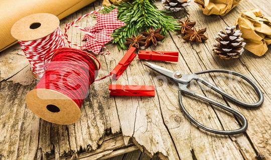 wrapping gift box equipment and decorating items on wood board, preparing for celebrating Christmas holidays - top view  : Stock Photo or Stock Video Download rcfotostock photos, images and assets rcfotostock | RC-Photo-Stock.: