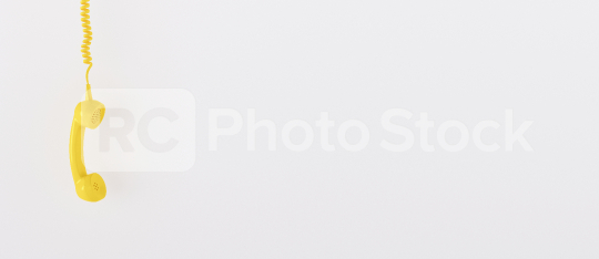 yellow telephone receiver with copy space for individual text against a white background, banner size  : Stock Photo or Stock Video Download rcfotostock photos, images and assets rcfotostock | RC-Photo-Stock.: