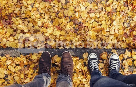 young man and his girl friend stands on a curbside at autumn, high angle footsie or flortrait, personal pespective from above.  : Stock Photo or Stock Video Download rcfotostock photos, images and assets rcfotostock | RC-Photo-Stock.: