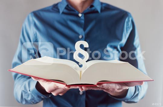 young man holding book with paragraph sign - law concept image  : Stock Photo or Stock Video Download rcfotostock photos, images and assets rcfotostock | RC-Photo-Stock.: