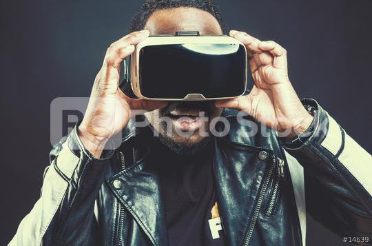 Young man wearing virtual reality googles / VR Glasses  : Stock Photo or Stock Video Download rcfotostock photos, images and assets rcfotostock   RC-Photo-Stock.: