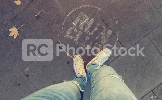 Young woman stands on the street with a info sign for a club party, personal pespective from above.  : Stock Photo or Stock Video Download rcfotostock photos, images and assets rcfotostock | RC-Photo-Stock.: